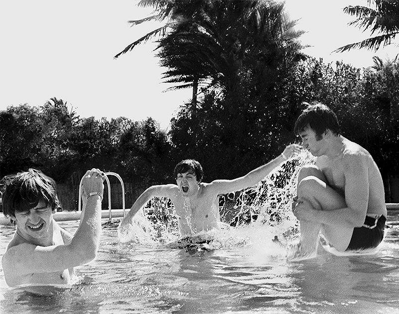 John Lennon cannonballs into the pool
